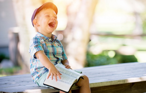laughing-boy-reading-book - Sarah Elliston